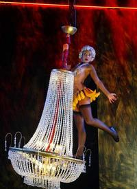 Paula Arundell swings from a chandelier during <i>Three Furies</i>.